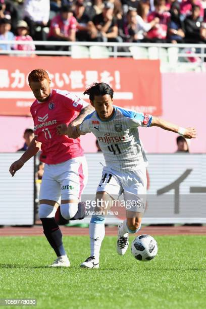 Akihiro Ienaga of Kawasaki Frontale and Souza of Cerezo Osaka compete for the ball during the JLeague J1 match between Cerezo Osaka and Kawasaki...