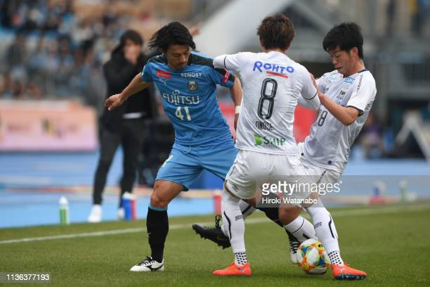 Akihiro Ienaga of Kawasaki Frontale and Takahiro Ko of Gamba Osaka compete for the ball during the JLeague J1 match between Kawasaki Frontale and...