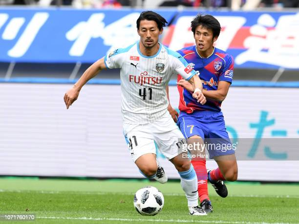 Akihiro Ienaga of Kawasaki Frontale and Takuji Yonemoto of FC Tokyo compete for the ball during the JLeague J1 match between FC Tokyo and Kawasaki...