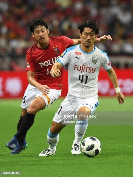 Akihiro Ienaga of Kawasaki Frontale and Takuya Aoki of Urawa Red Diamonds compete for the ball during the JLeague J1 match between Urawa Red Diamonds...