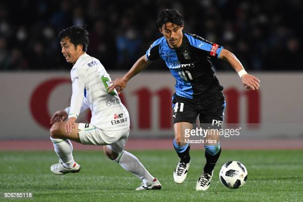 Akihiro Ienaga of Kawasaki Frontale and Toshiki Ishikawa of Shonan Bellmare compete for the ball during the JLeague J1 match between Kawasaki...