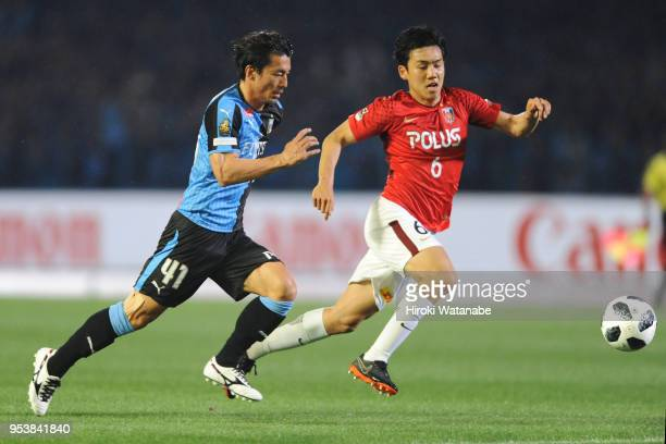 Akihiro Ienaga of Kawasaki Frontale and Wataru Endo of Urawa Red Diamonds compete for the ball during the JLeague J1 match between Kawasaki Frontale...