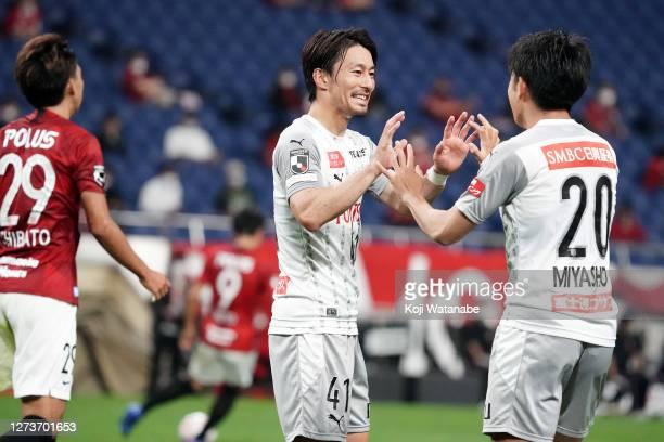 Akihiro Ienaga of Kawasaki Frontale celebrates his team mates third goal during the J.League Meiji Yasuda J1 match between Urawa Red Diamonds and...