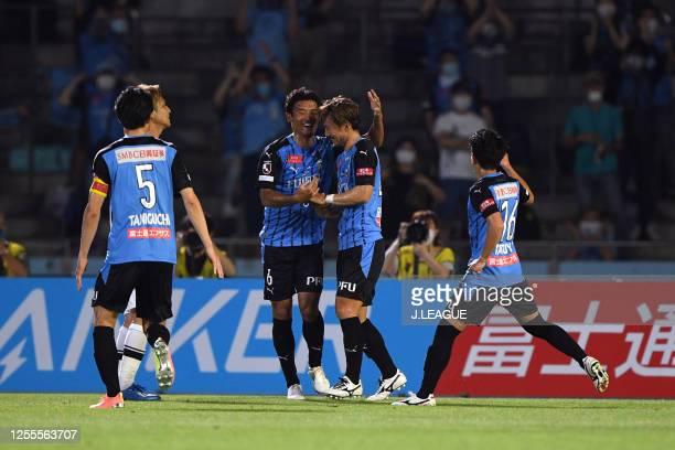Akihiro Ienaga of Kawasaki Frontale celebrates scoring his side's first goal with his team mates during the J.League Meiji Yasuda J1 match between...