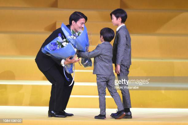 Akihiro Ienaga of Kawasaki Frontale celebrates the JLeague Player of the Year Awards with his children during the JLeague Awards at Yokohama Arena on...