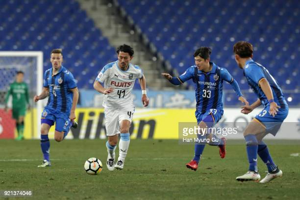 Akihiro Ienaga of Kawasaki Frontale competes for the ball against Park Jooho of Ulsan Hyndai during the AFC Champions League Group F match between...