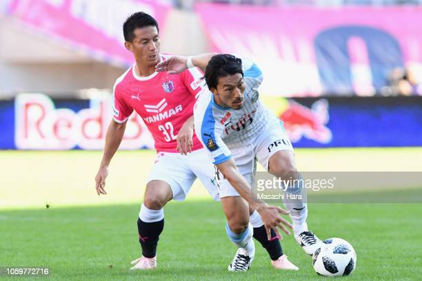 Akihiro Ienaga of Kawasaki Frontale controls the ball under pressure of Atomu Tanaka of Cerezo Osaka during the JLeague J1 match between Cerezo Osaka...