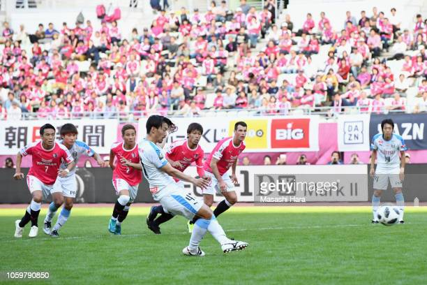 Akihiro Ienaga of Kawasaki Frontale converts the panelty kick to score his side's first goal during the JLeague J1 match between Cerezo Osaka and...