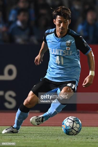 Akihiro Ienaga of Kawasaki Frontale in action during the AFC Champions League Round of 16 match between Kawasaki Frontale and Muangthong United at...