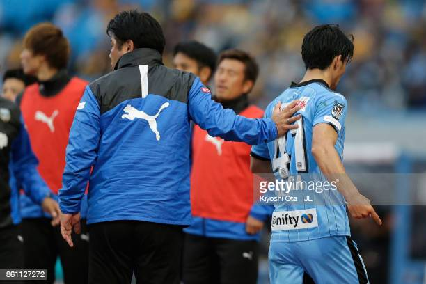 Akihiro Ienaga of Kawasaki Frontale leaves the pitch after receiving a red card during the JLeague J1 match between Kawasaki Frontale and Vegalta...