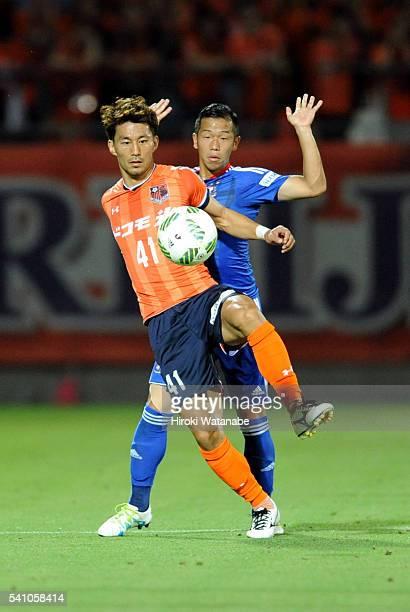 Akihiro Ienaga of Omiya Ardija controls the ball under pressure of Takuya Kida of Yokohama F.Marinos during the J.League match between Omiya Ardija...