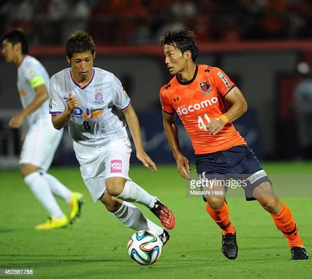 Akihiro Ienaga of Omiya Ardija in action during the J. League 2014 match between Omiya Ardija and Sandrecce Hiroshima at the Nack 5 Stadium Omiya on...