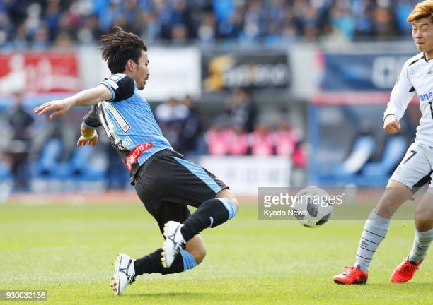 Akihiro Ienaga scores with a volley for Kawasaki Frontale in their 20 win over Gamba Osaka in a JLeague first division match in Kawasaki on March 10...