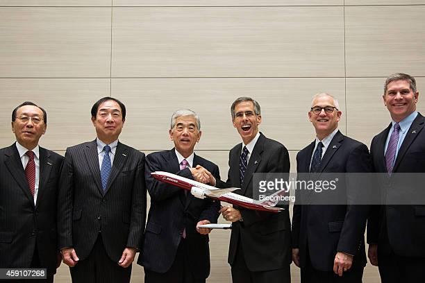 Akihiro Nikkaku president of Toray Industries Inc center left and John Tracy senior vice president of Engineering Operations Technology at Boeing Co...