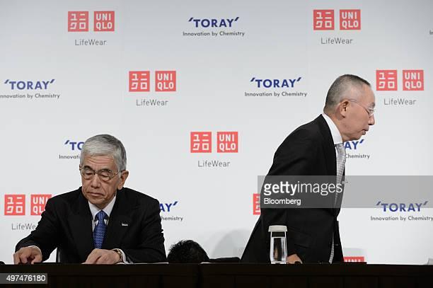 Akihiro Nikkaku president of Toray Industries Inc left looks on as billionaire Tadashi Yanai chairman and chief executive officer of Fast Retailing...