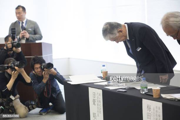 Akihiro Nikkaku president of Toray Industries Inc second right bows during a news conference in Tokyo Japan on Tuesday Nov 28 2017 The falling...