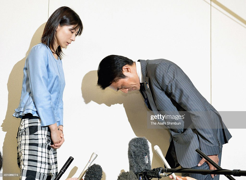 Akihiro Suzuki (R), a Tokyo metropolitan assembly member, apologizes to his colleague Ayaka Shiomura (L) at the assembly building on June 23, 2014 in Tokyo, Japan. Suzuki belatedly admitted to sexually taunting Shiomura during the June 18 assembly session. Shiomura asked Suzuki an cooperation to identify the man of another taunt directed at Shiomura, apparently from the assembly section reserved for LDP members, was, 'Can't you even bear a child?'