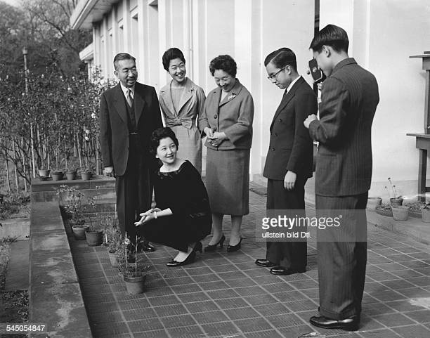 Akihito Crown Prince of Japan and his family the Imperial family in front of the Imperial Palace in Tokyo from left Emperor Hirohito Crown Princess...