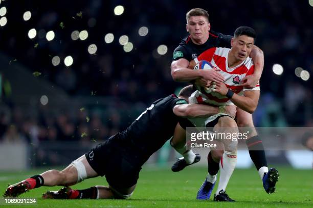 Akihito Yamada is tackled by Owen Farrell and Mark Wilson during the Quilter International match between England and Japan at Twickenham Stadium on...