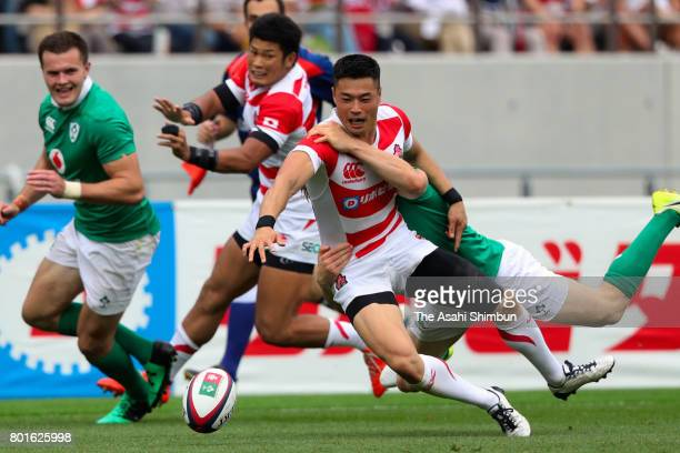 Akihito Yamada of Japan is tackled during the international test match between Japan and Ireland at Ajinomoto Stadium on June 24 2017 in Chofu Tokyo...