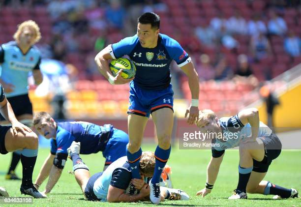Akihito Yamada of the Panasonic Wild Knights breaks through the defence during the Rugby Global Tens match between the Panasonic Wild Knights and New...