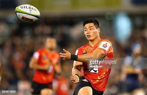 Akihito Yamada of the Sunwolves passes during the round 14 Super Rugby match between the Brumbies and the Sunwolves at GIO Stadium on May 28 2016 in...