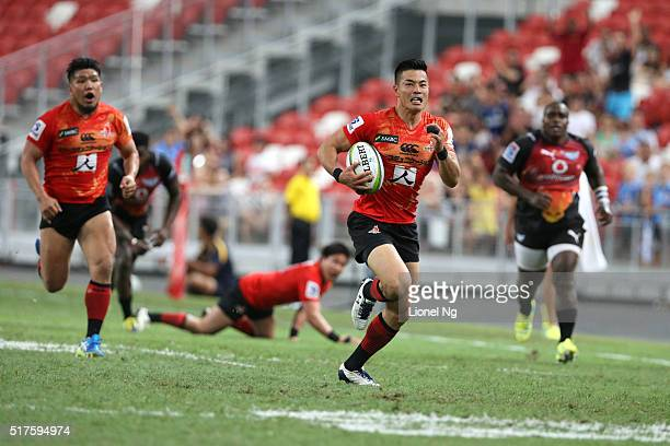 Akihito Yamada of the Sunwolves runs and scores a try during the round five Super Rugby match between the Sunwolves and the Bulls at Singapore...