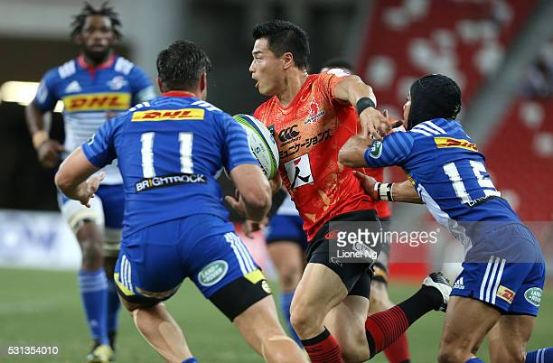Akihito Yamada of the Sunwolves runs with the ball while avoiding Cheslin Kolbe of the Stormers during the round 12 Super Rugby match between the...