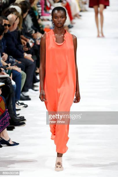 Akiima walks the runway during the Valentino show as part of the Paris Fashion Week Womenswear Spring/Summer 2018 on October 1 2017 in Paris France