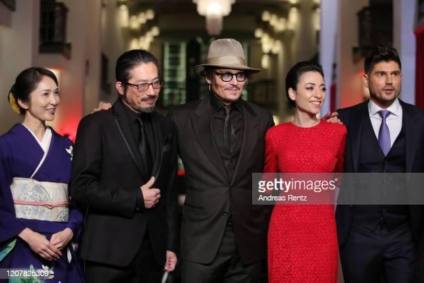 Akiko Iwase Hiroyuki Sanada Johnny Depp Minami and director Andrew Levitas pose at the Minamata premiere during the 70th Berlinale International Film...