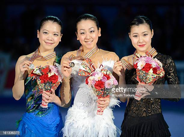 Akiko Suzuki of Japan Mao Asada of Japan and Kanako Murakami of Japan pose after the medals ceremony for the Ladies single competition during day...