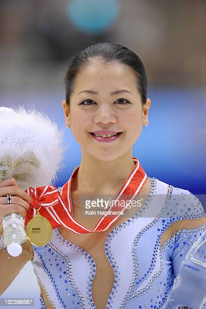 Akiko Suzuki of Japan poses for photograghs in the women's singles during day two of the ISU Grand Prix of Figure Skating NHK Trophy at Makomanai...