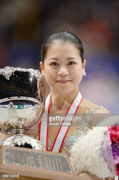 Akiko Suzuki of Japan poses in the victory ceremony during All Japan Figure Skating Championships at Saitama Super Arena on December 23 2013 in...