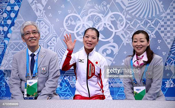 Akiko Suzuki of Japan waits for her score with her coaches Hiroshi Nagakubo and Miho Kawaume in the Figure Skating Ladies' Short Program on day 12 of...