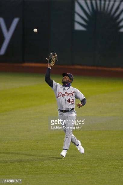 Akil Baddoo of the Detroit Tigers catches a sacrifice fly ball hit by Elvis Andrus of the Oakland Athletics in the bottom of the fourth inning at...