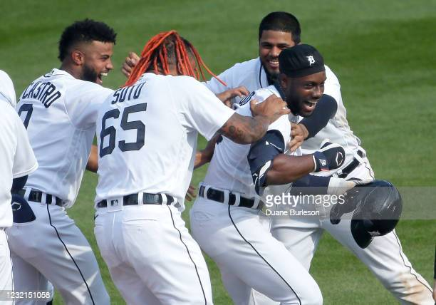 Akil Baddoo of the Detroit Tigers, right, celebrates with Willi Castro, Gregory Soto and Jeimer Candelario after hitting a single to drive in Harold...