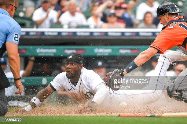 Akil Baddoo of the Detroit Tigers scores a run on a sacrifice bunt by Robbie Grossman of the Detroit Tigers to win the game against the Houston...