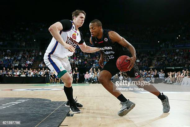 Akil Mitchell of New Zealand drives against Cameron Bairstow of Brisbane during the round five NBL match between the New Zealand Breakers and the...