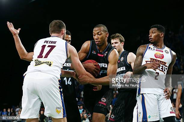 Akil Mitchell of New Zealand protects the ball against Anthony Petrie of Brisbane during the round five NBL match between the New Zealand Breakers...