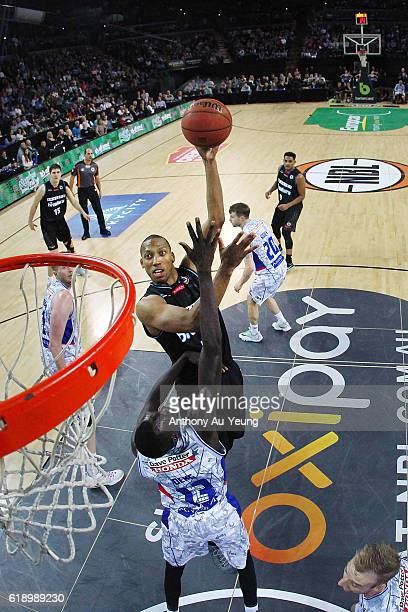 Akil Mitchell of New Zealand puts up a shot against Majok Deng of Adelaide during the round four NBL match between the New Zealand Breakers and the...