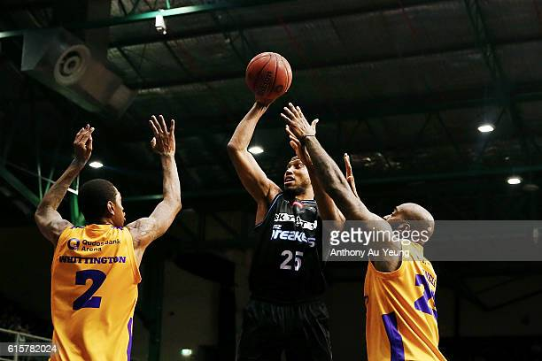 Akil Mitchell of New Zealand takes a shot against Greg Whittington and Josh Powell of Sydney during the round three NBL match between the New Zealand...