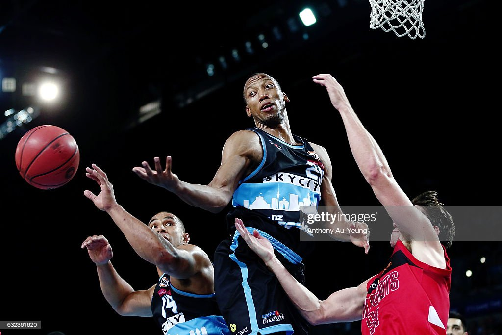 Akil Mitchell of the Breakers competes for a rebound against Damian Martin of the Wildcats during the round 16 NBL match between the New Zealand Breakers and the Perth Wildcats at Vector Arena on January 22, 2017 in Auckland, New Zealand.