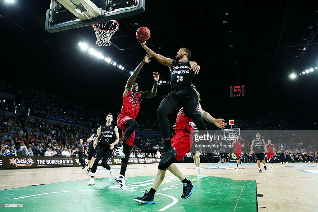 Akil Mitchell of the Breakers goes to the basket against Casey Prather of the Wildcats during the round 11 NBL match between New Zealand Breakers and Perth Wildcats at Vector Arena on December 15, 2016 in Auckland, New Zealand.