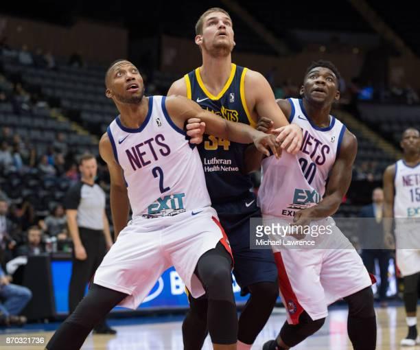 Akil Mitchell of the Long Island Nets Adam Woodbury of the Fort Wayne Mad Ants Yakuba Ouattara of the Long Island Nets during an NBA GLeague game on...
