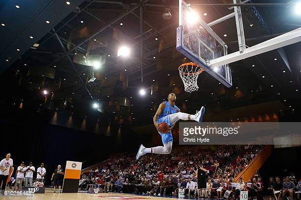 Akil Mitchell of the New Zealand Breakers dunks during the dunk contest during the Australian Basketball Challenge at Brisbane Convention and...