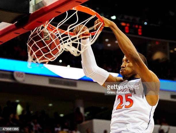 Akil Mitchell of the Virginia Cavaliers dunks against the Coastal Carolina Chanticleers in the first half during the Second Round of the 2014 NCAA...