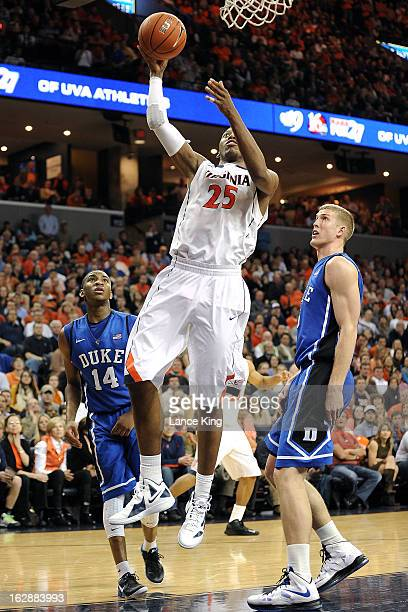 Akil Mitchell of the Virginia Cavaliers goes to the hoop against the Duke Blue Devils at John Paul Jones Arena on February 28 2013 in Charlottesville...