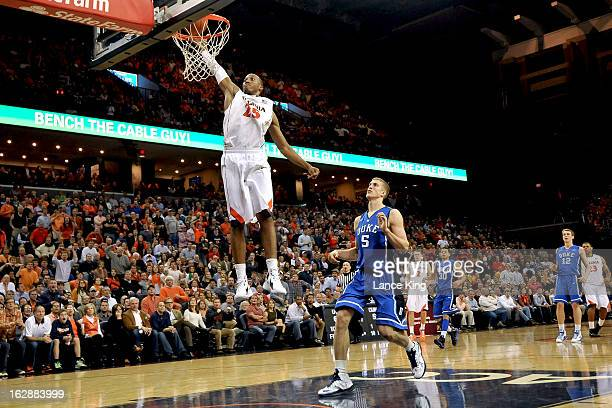 Akil Mitchell of the Virginia Cavaliers goes up for a dunk against the Duke Blue Devils at John Paul Jones Arena on February 28 2013 in...