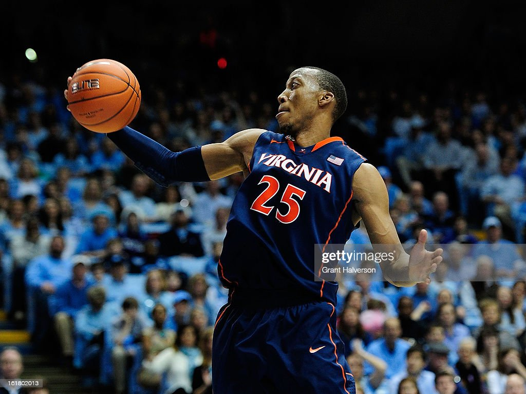 Akil Mitchell #25 of the Virginia Cavaliers rebounds against the North Carolina Tar Heels during play at the Dean Smith Center on February 16, 2013 in Chapel Hill, North Carolina. North Carolina won 93-81.
