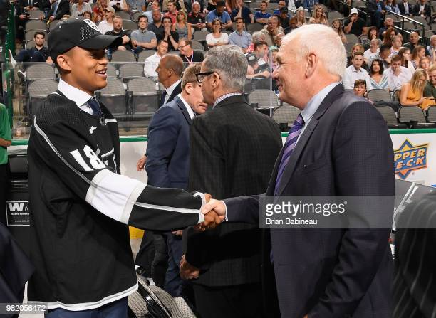 Akil Thomas greets his team after being selected 51st overall by the Los Angeles Kings during the 2018 NHL Draft at American Airlines Center on June...
